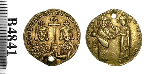 Pierced gold solidus of Emperor Romanus I, showing him being crowned by Christ, with his son-in-law Constantine VII and his son Christopher sharing a cross on the reverse. Struck in Constantinople between 919 and 931, though narrower guesses have been made; Barber Institute of Fine Arts B4841
