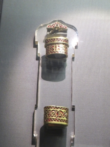 Two gold and garnet collar-pieces from a sword hilt, from the Staffordshire Hoard, on display at the Royal Armouries Museum, Leeds