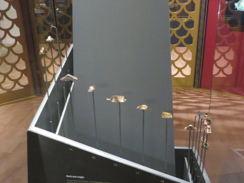 Array of gold fittings from wargear from the Staffordshire Hoard, on display at the Royal Armouries Museum, Leeds