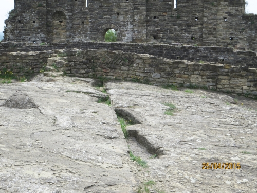 Anthropomorphic rock-cut tombs in the courtyard before Sant Pere de Roda de Ter