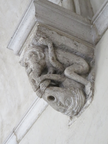 Grotesque human and animal combination on a wall inside the Cloisters, Metropolitan Museum of New York
