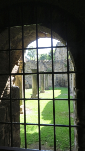 Window view onto a courtyard at Kirkstall Abbey