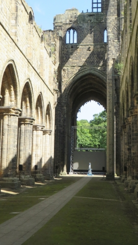 View from the west end of the north aisle of the church eastwards at Kirkstall Abbey