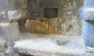 A basin in the side-wall of one of the apsidal chapels in the east end of the church at Kirkstall Abbey