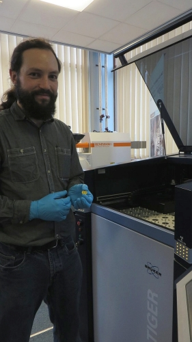 Jonathan Jarrett and a gold solidus with XRF machinery in the Department of Chemistry, University of Birmingham
