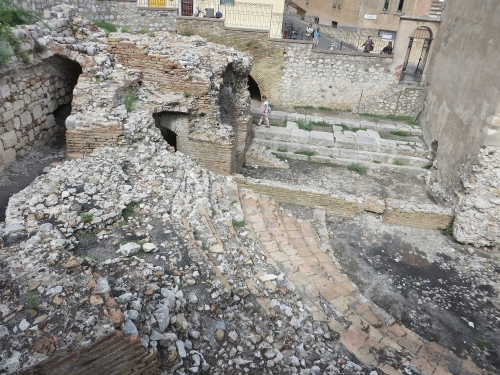 View down onto the surviving entry and stage right of the Odeon, Taormina