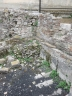Fallen stonework at one of the walls of the Roman baths, Taormina