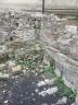Fallen stonework at one of the walls of the Roman baths, Taormina