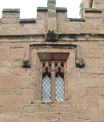 Grotesques around a late medieval window at All Saints Claverley