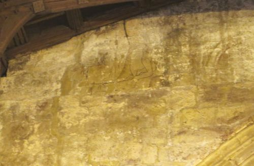 A kneeling figure in fresco in the tower of All Saints Church, Claverley