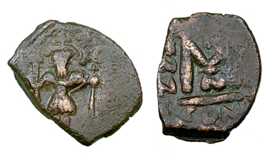 Copper-alloy 4-<i>nummi</i> of the Emperor Heraclius, overstruck at Constantinople onto a cut portion of an older coin, probably of Anastasius I or Justinian I, in the early seventh century, Birmingham, Barber Institute of Fine Arts B3732