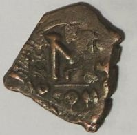 Reverse of a copper-alloy forty-nummi struck onto a cut section of an old coin at Constantinople in 635/6, Leeds, Brotherton Library, Thackray Collection, CC/TH/BYZ/58