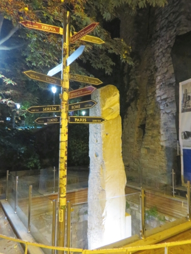 Roman milestone in Istanbul with up-to-date distances on a new signpost beside it