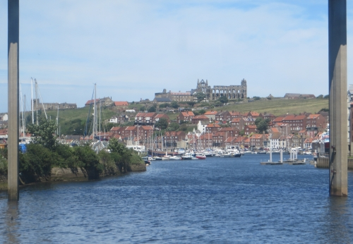 Whitby harbour and Whitby Abbey seen from the North Yorkshire Moors Railway service into the town