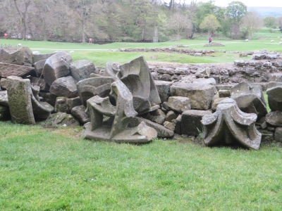 Fallen stonework at Bolton Abbey Priory