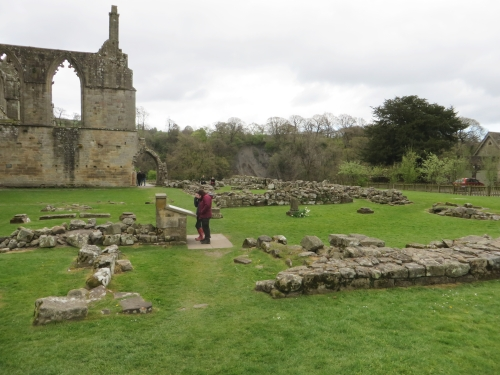 Two visitors pondering the remains at Bolton Abbey Priory