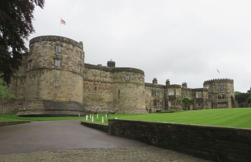 Inner wall, towers and private buildings at Skipton Castle, seen from the bailey