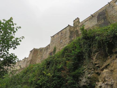 Walls of Skipton Castle seen from the canal below