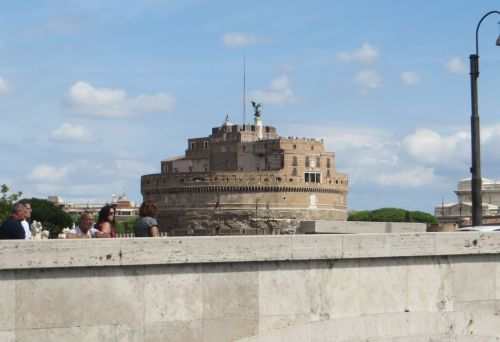 Distant view of the Castel Sant'Angelo, Rome, from a bridge over the Tiber