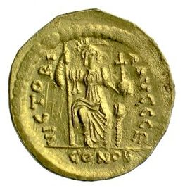 Reverse of a gold solidus of Emperor Justin II struck at Constantinople 565-578, Birmingham, Barber Institute of Fine Arts, B1154, showing Victory seated half-right with long sceptre and cross on globe