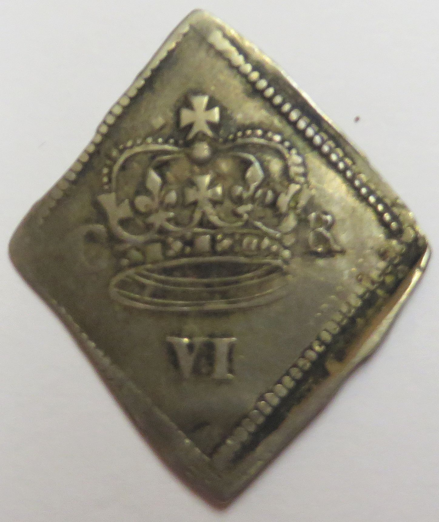 Obverse of a silver sixpence of King Charles I struck in Newark Castle, 1646, Blackburn Museum and Art Gallery