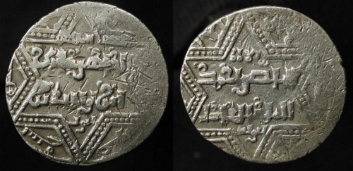 Silver imitation dirham struck in the name of the late al-Zahir Ghazi of Aleppo, probably at Crusader Acre, in the 1240s